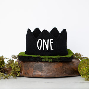 Black knitted crown with ONE in white script lettering