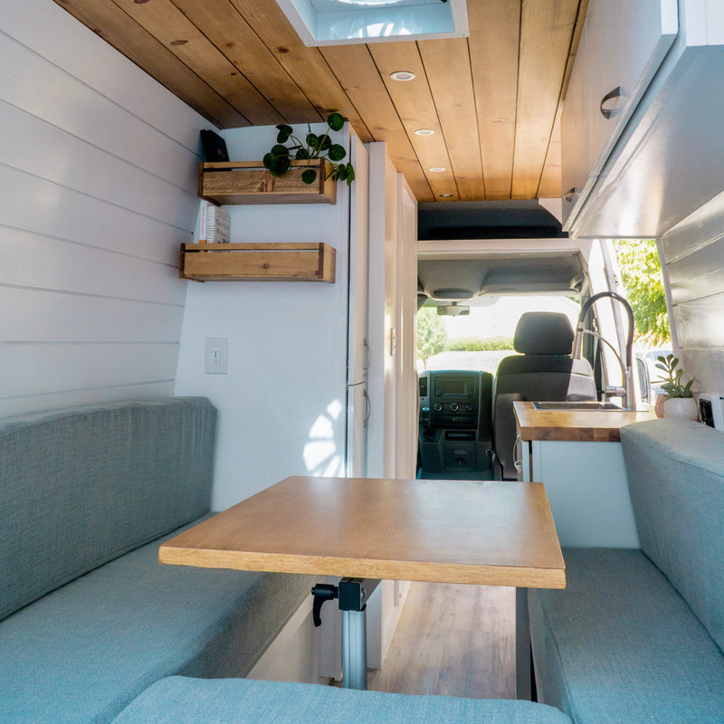 Modern Van conversion with DIY headliner shelf