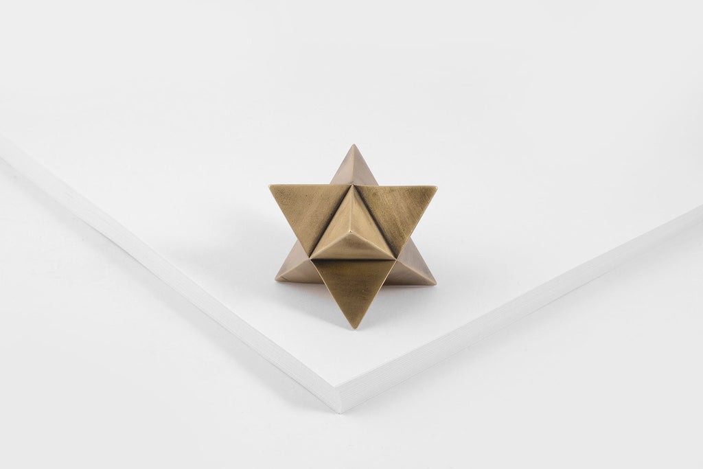 MERKABA paperweight <br> <i>aged brass finish</i>