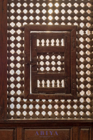 Mashrabiya Pattern-The Maymoni as seen in a wooden latticed window with two small swinging sashes in Cairo, Egypt.