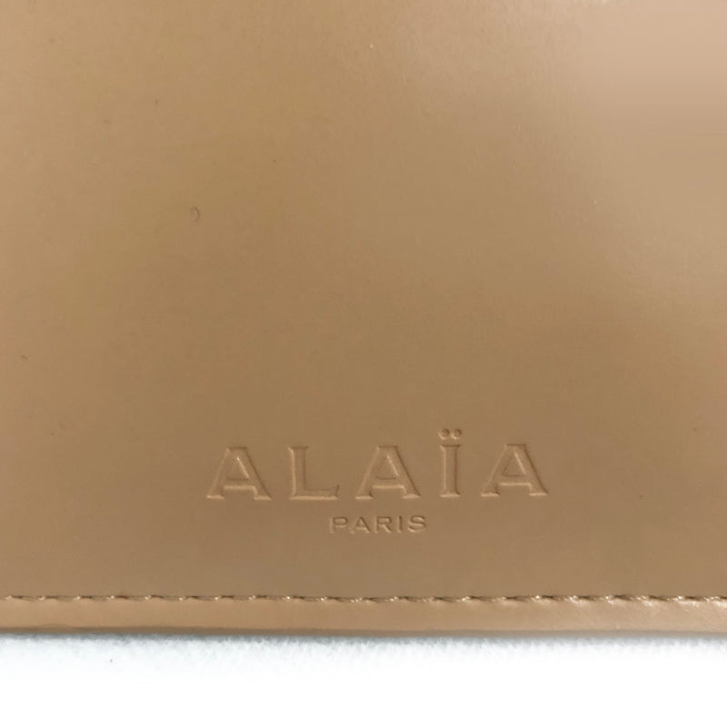 ALAÏA nude leather pouch