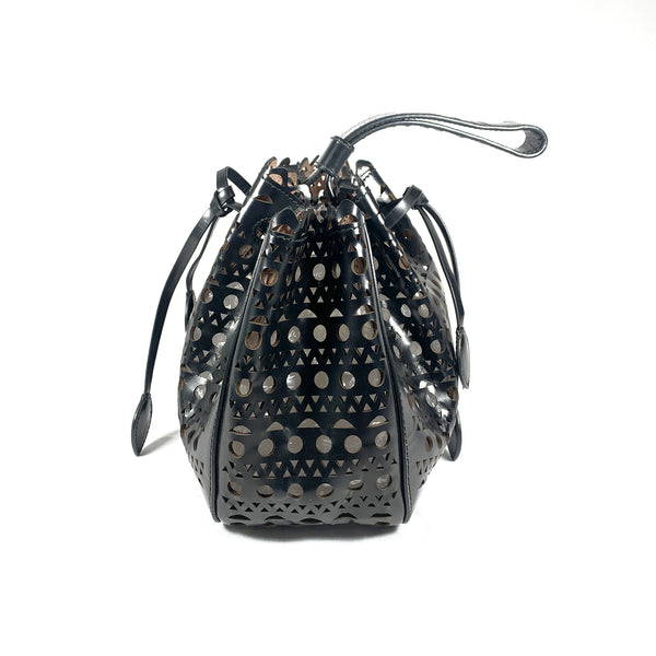 pre-loved ALAÏA black leather laser cut basket handbag with an inside mirror