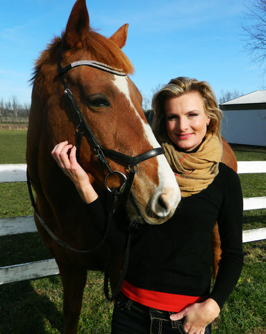 Equestrianista founder Julie Fryman and her Thoroughbred gelding.