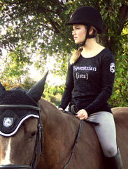 Equestrianista offers stylish women's equestrian apparel; riding shirts, horse-inspired sweatshirts & tees, equestrian sweaters, jackets, ponchos and more! Equestrian clothing designed to be fabulously feminine in style, quality and fit.