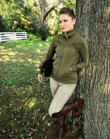 Fashionista Full Zip in Olive paired with Dover Saddlery plaid breeches, Mountain Horse Sovereign brown tall boots and IRH riding helmet.