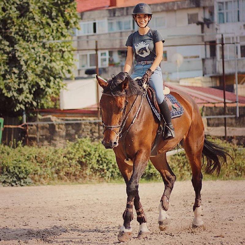 From street to stable equestrian fashion. Equestrian Trend shown here schooling her bay warmblood gelding in her EQUESTRIANISTA short sleeve tee.