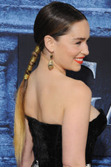 Emilia Clarke trendy ponytail wrapped in gold thread.