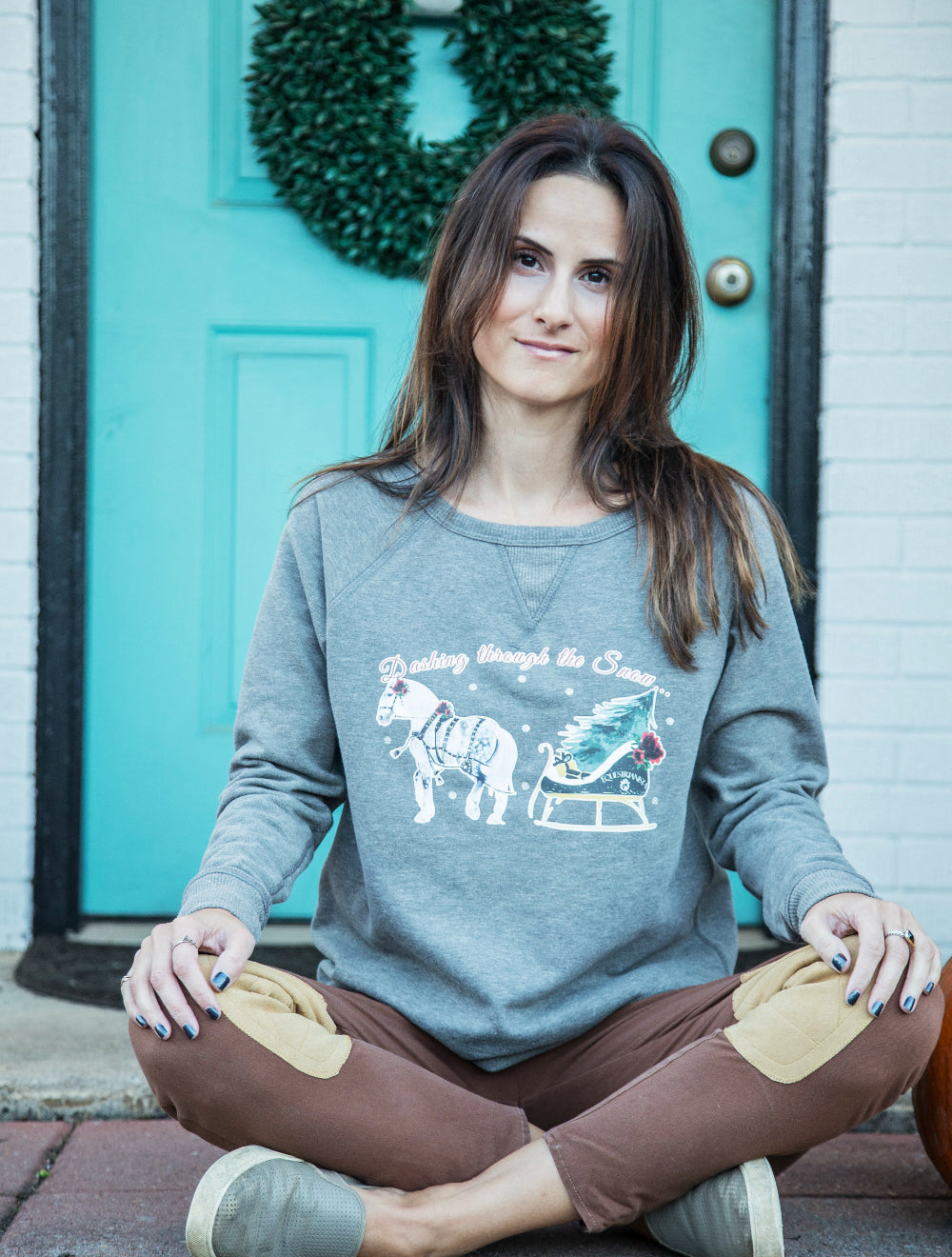 Equestrianista One Horse Open Sleigh holiday pullover modeled by Horse Glam Equestrian Lifestyle Blogger.