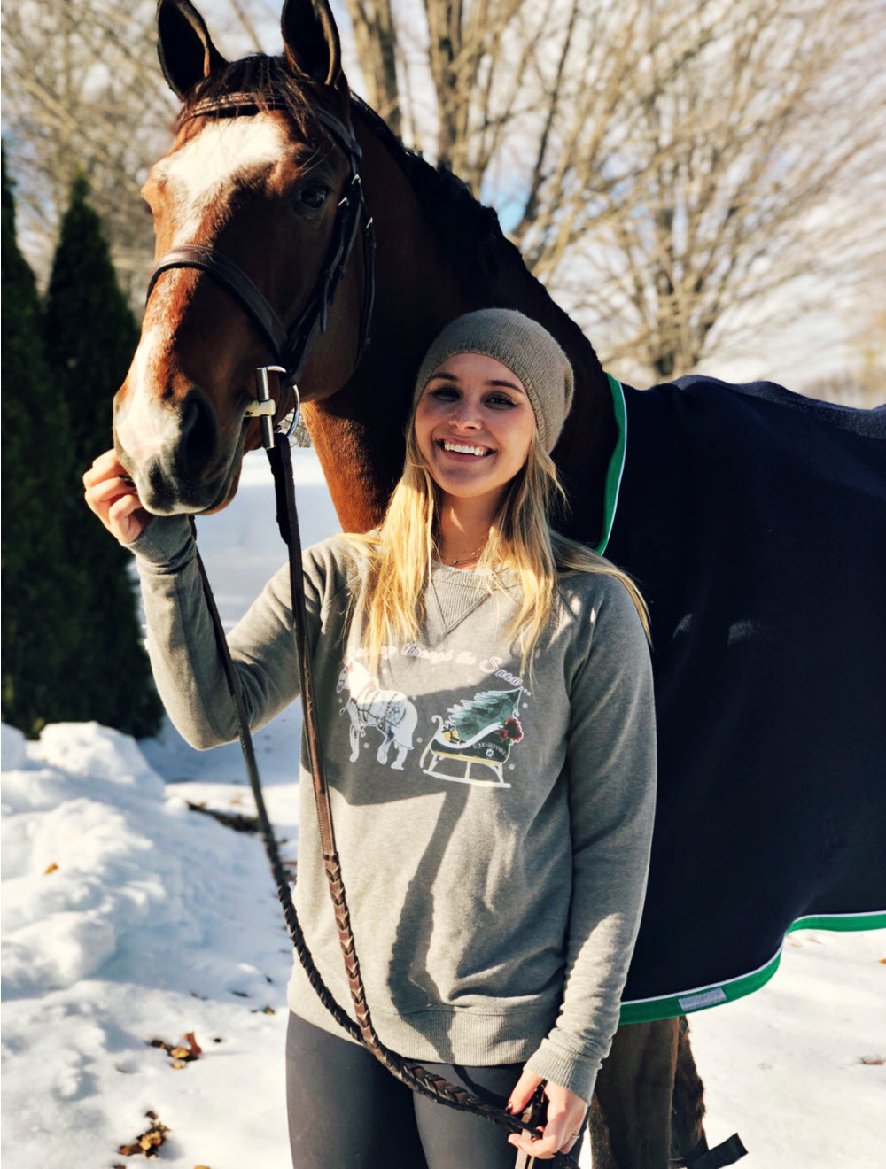 Equestrianista One Horse Open Sleigh holiday pullover modeled by the East Coast Equestrian Lifestyle Blogger.