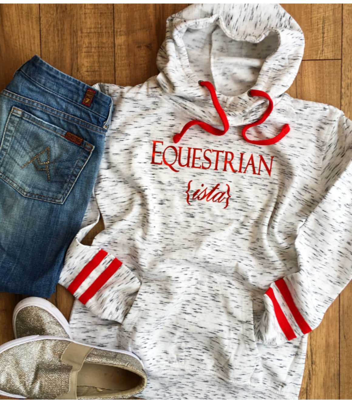 Equestrianista Varsity Hoodie Fleece paired with Seven Jeans and Guess Glitter Loafers.