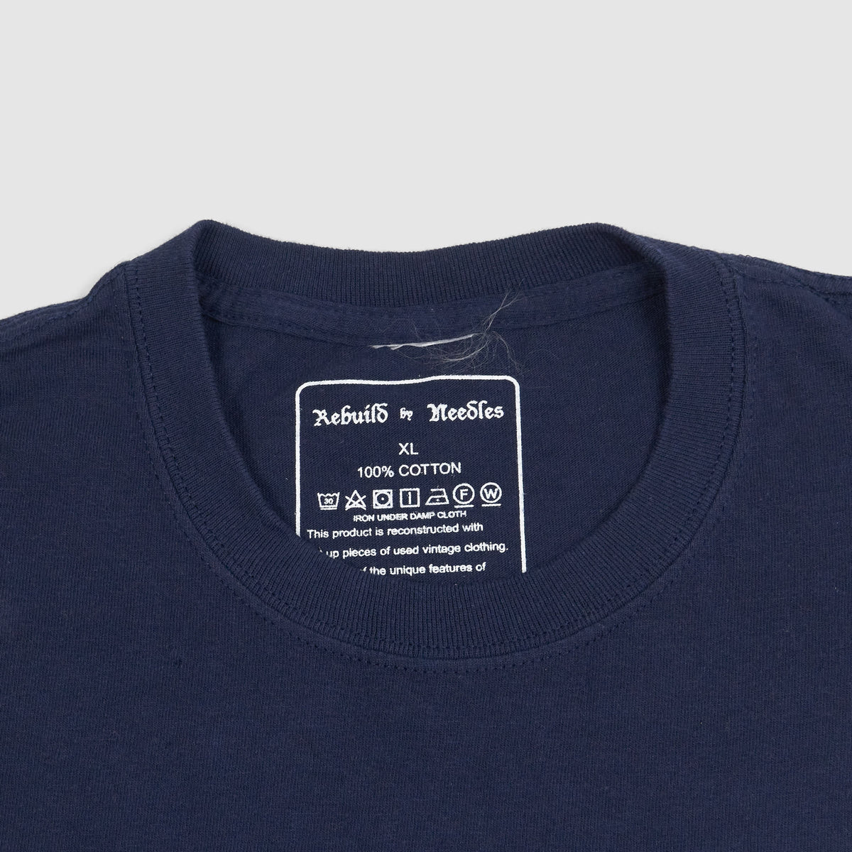 Needles Rebuilt 7-Cuts T-Shirt