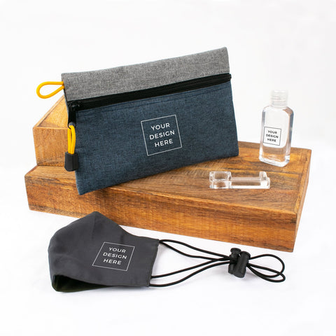 A flat lay showing a customizable care kit consisting of a zip pouch, face mask, sanitizer and an acrylic no-touch tool