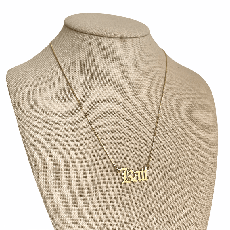 gold name plate necklace on mannequin