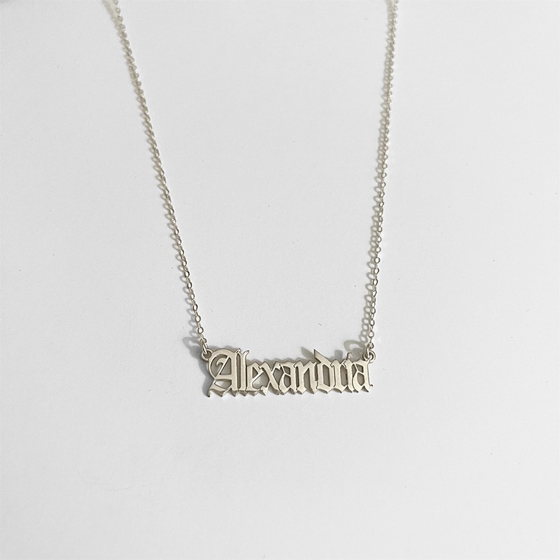 custom name necklace on gray background