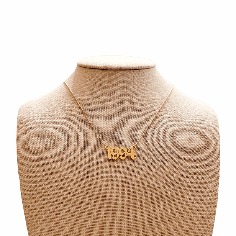 gold number pendant necklace on mannequin