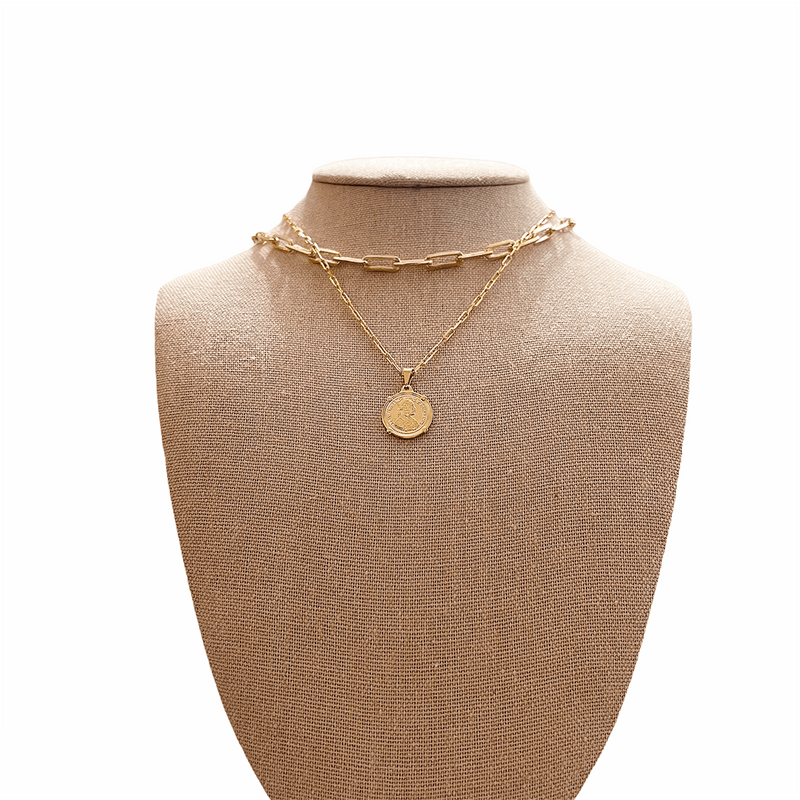 gold coin necklace & gold paper clip necklace on mannequin