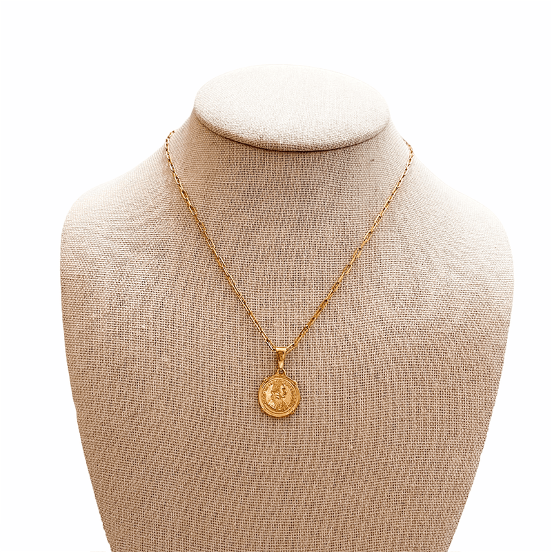 gold coin pendant on mannequin