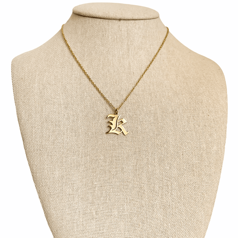 dainty initial necklace in gold on mannequin