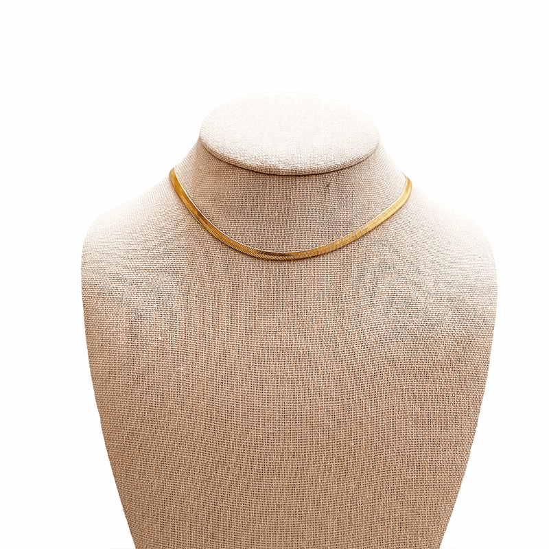 gold herringbone choker necklace on mannequin