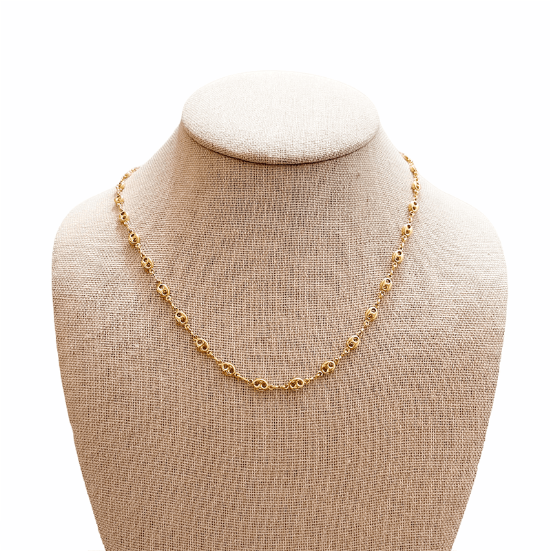 gold stackable necklace on mannequin