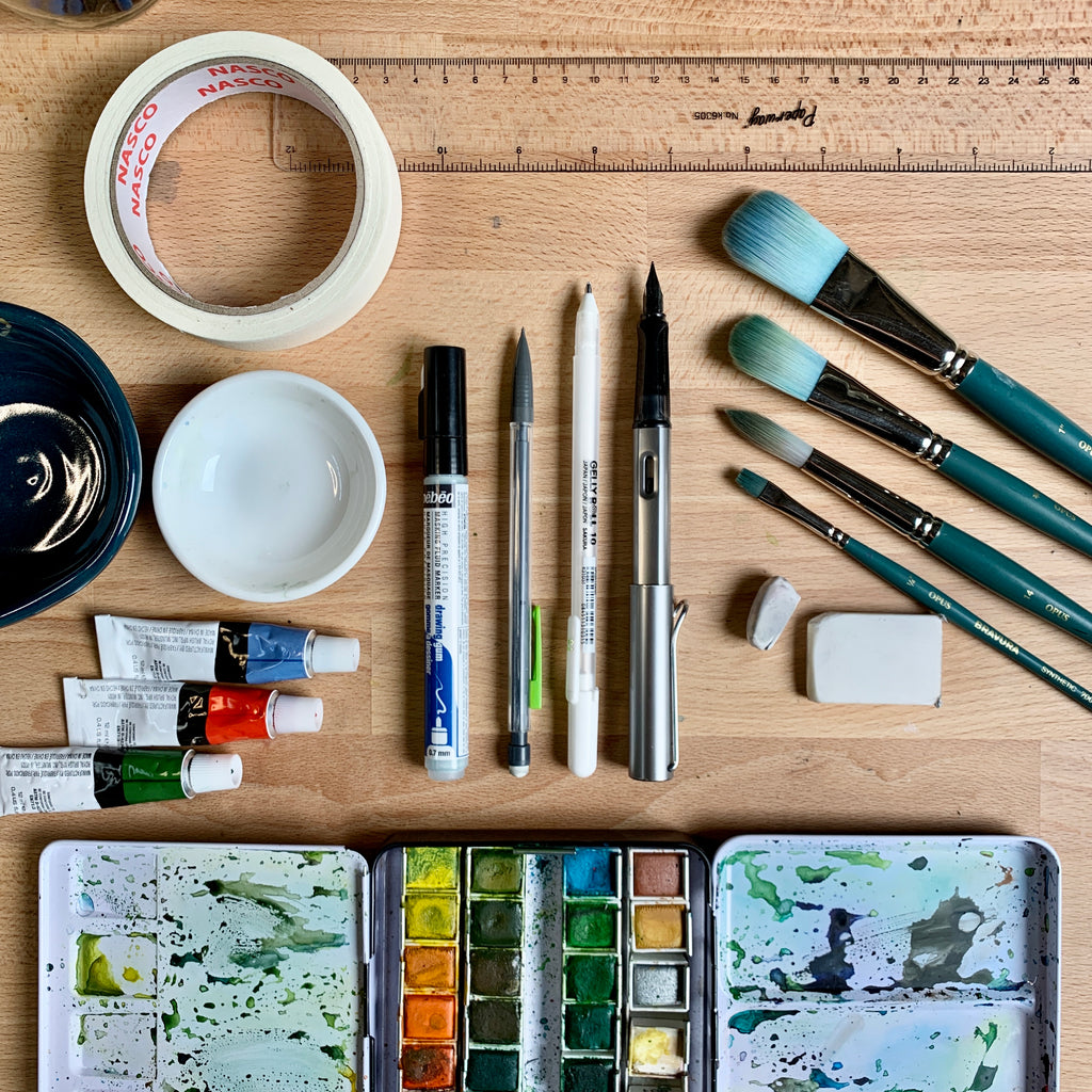Flatlay image of watercolour painting materials