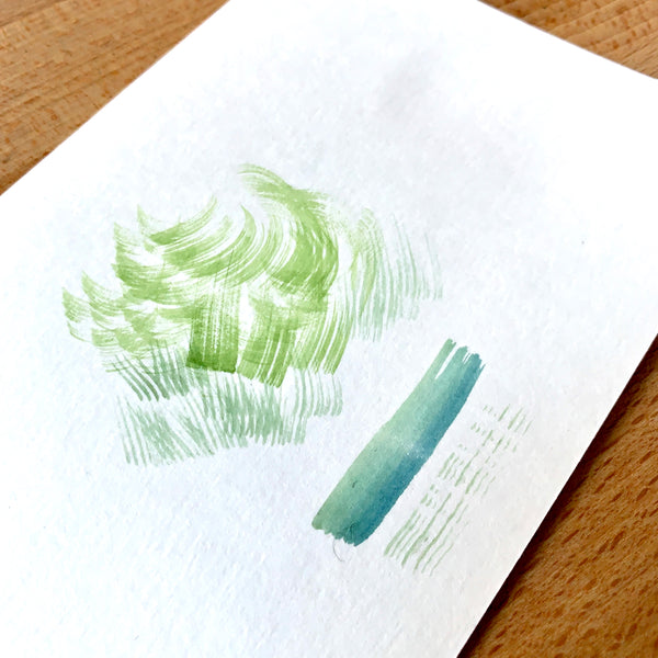 Close up of a dry brushing watercolour technique in green paint
