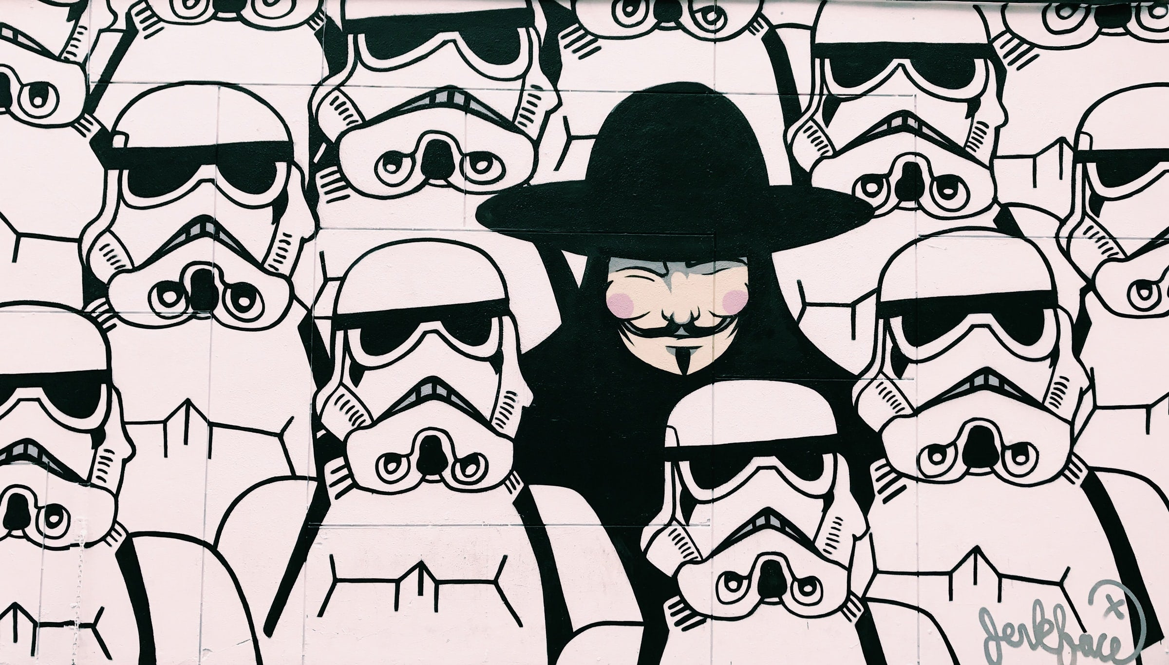 Richard Thompson Unsplash Image - Guy Fawkes standing in the middle of Storm Troopers illustration