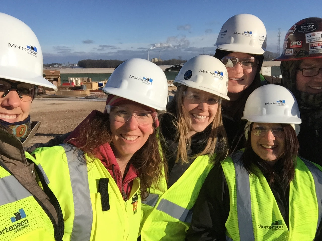 Robbie Oldenburg on a construction site with her team