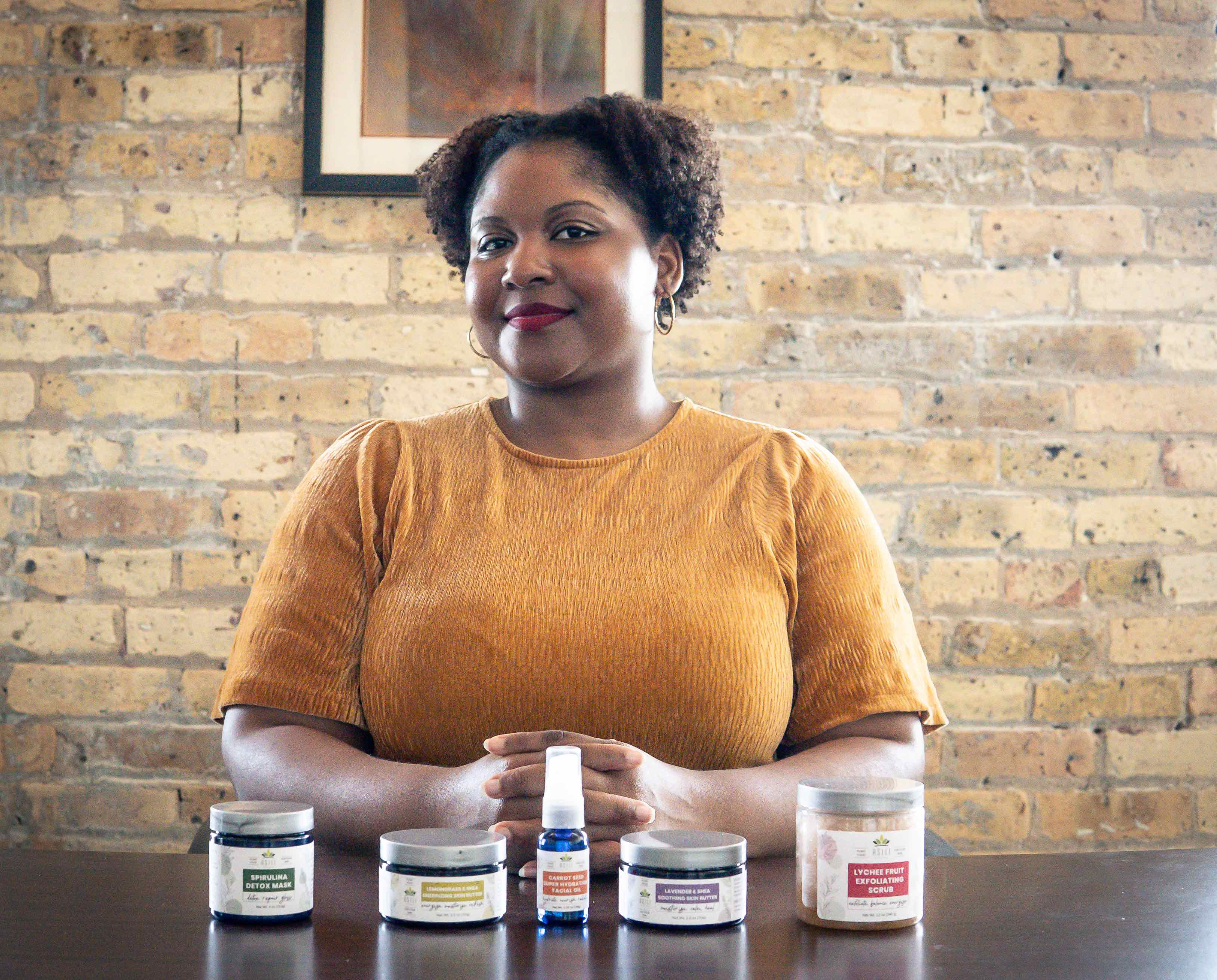 Trenise Watson next to her Asili Naturals creations
