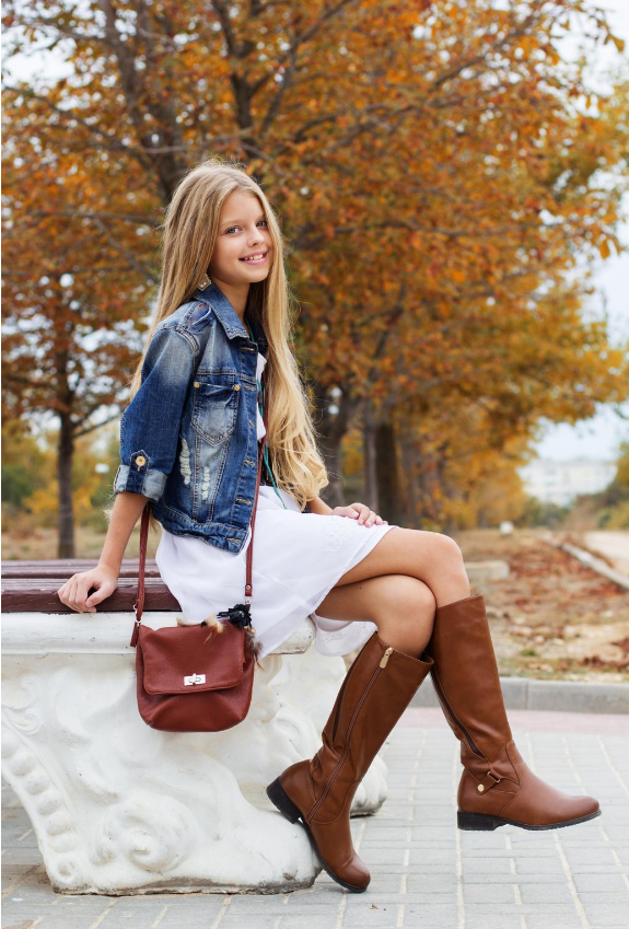 Brown knee high rider boots with white mini flowy dress