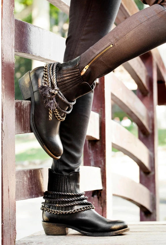 Black leather ankle boots with embellishments