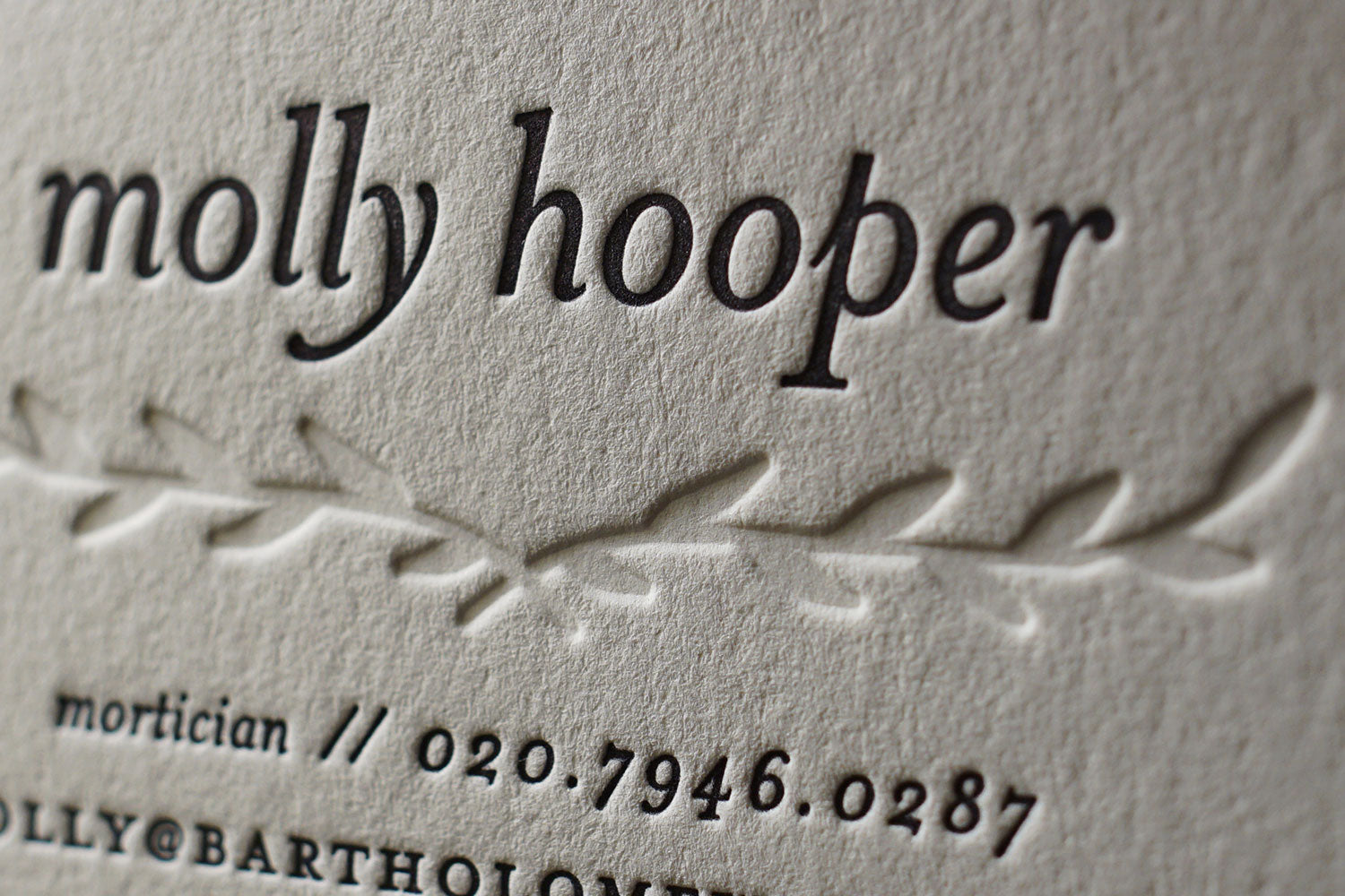 A close up example of a letterpress printed calling card