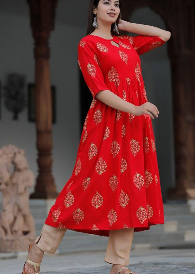 Long red kurti and pant with beautiful floral prints