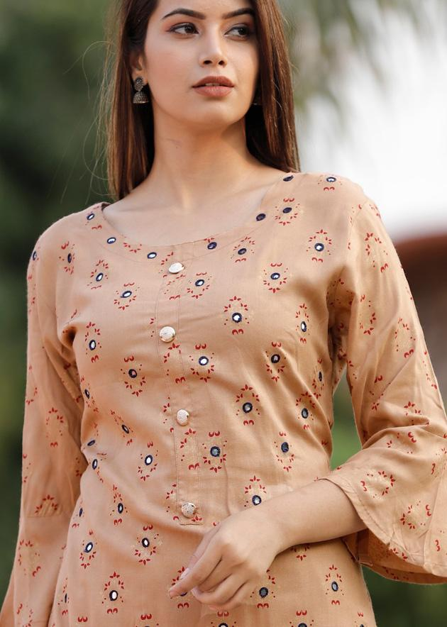 Light beige colour kurti and sharara with embroidery and prints
