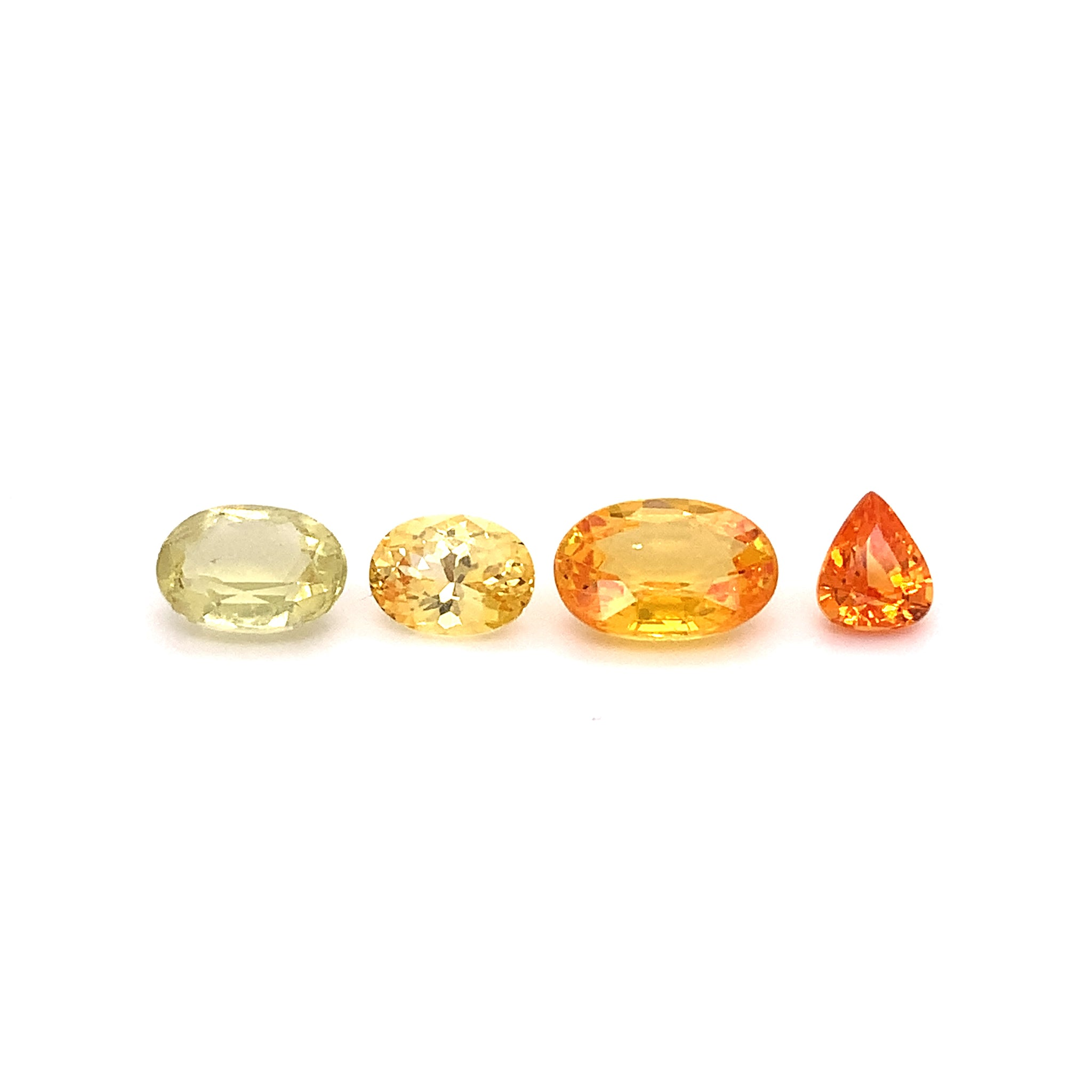 Picture of four yellow and yellow-orange sapphires
