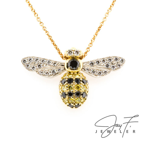 Custom made bee necklace with a bee pendant made out of black, yellow, and white diamonds.