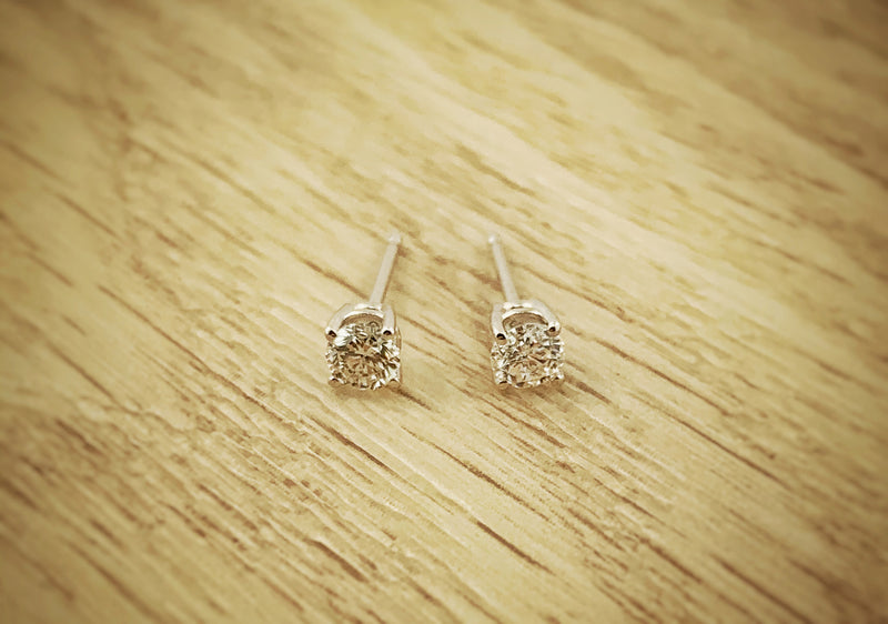 14k white gold studs featuring .33ctw Diamonds