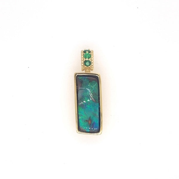 18k yellow gold pendant featuring a 4.42ct rectangular Boulder Opal and three 2mm AAA Tsavorite Garnets. Chain not included.