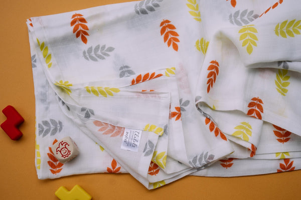 Leaves Muslin Cotton Swaddles for Baby wrap. Versatile blankets that can be used as breasteeding covers, stroller covers, towels and changing mat.