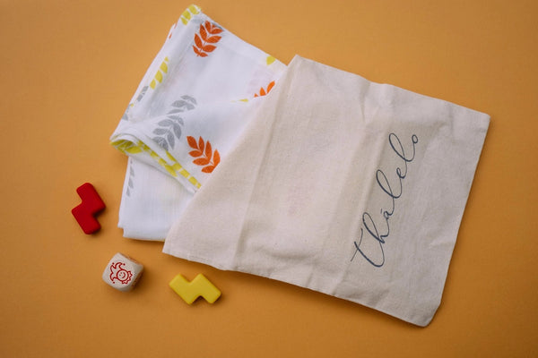 Thalelo swaddle in eco-friendly bag
