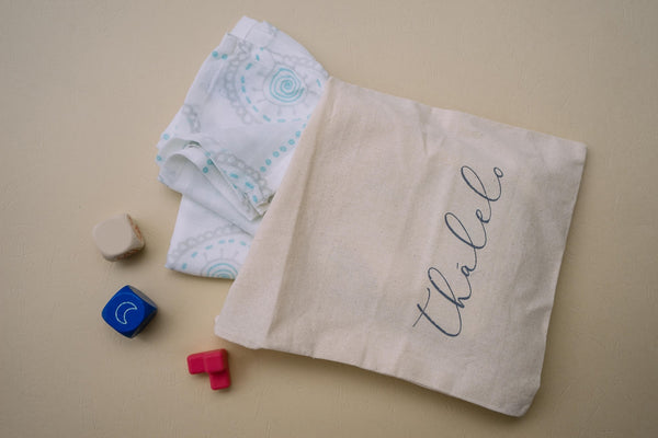 Thalelo swaddle in eco-friendly bag/pouch