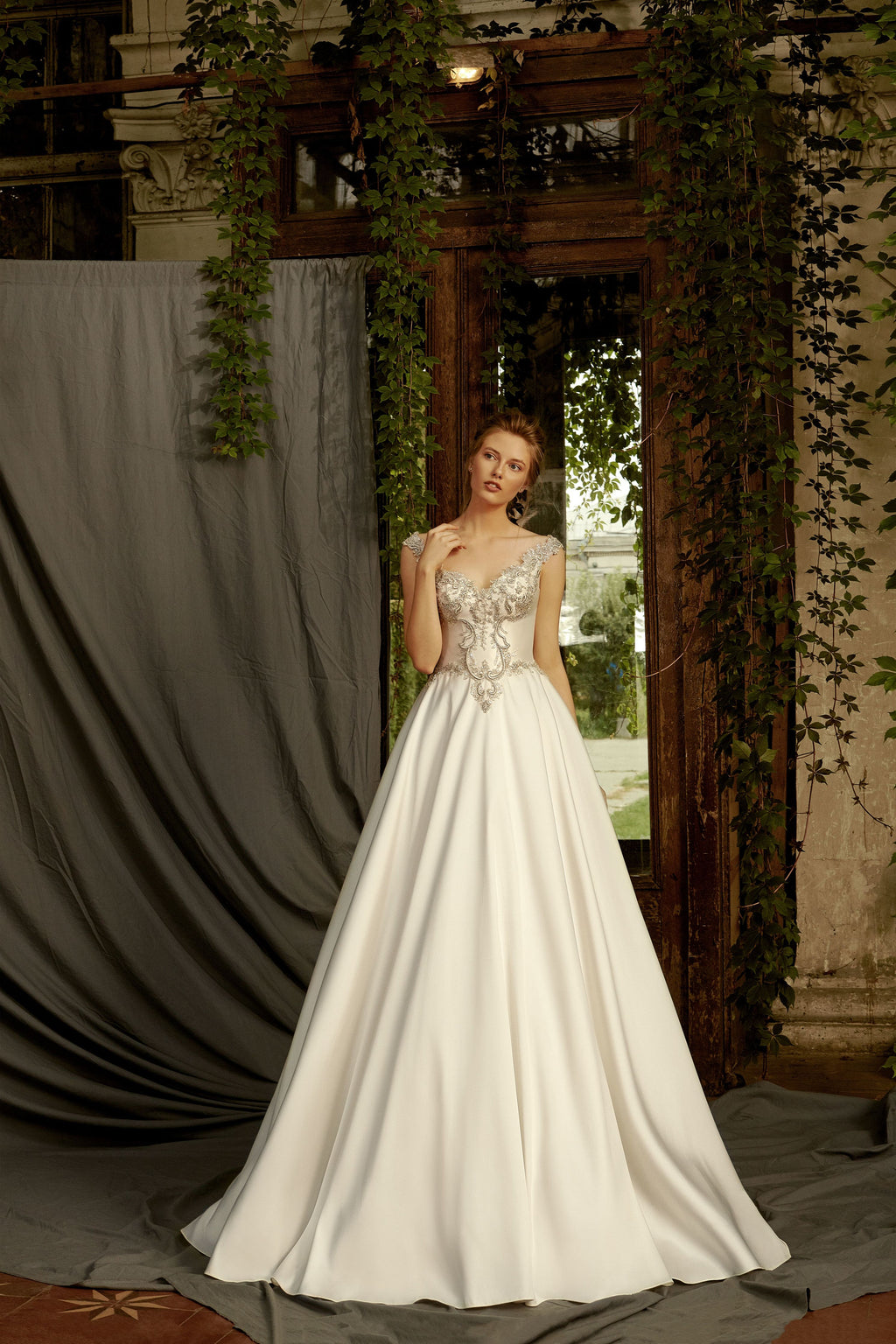 This gorgeous A-line dress features an embroidered sweetheart bodice decorated with beads and a classy train.