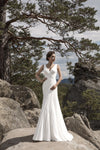 This chiffon asymmetrically draped wedding gown features a V-neck and an elegant V-back decorated with lace appliques.