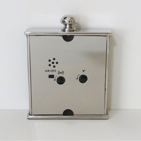Back view small square black enamel and silver metal alarm clock.
