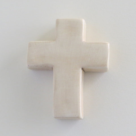 Matt cream plain ceramic cross.