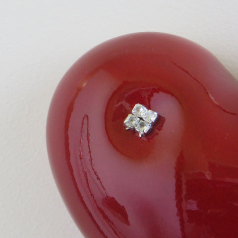 Close up of red ceramic heart with diamantes.