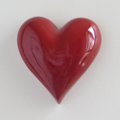 Ceramic heart in red, plain style.