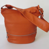Baby Anton handbag in orange.