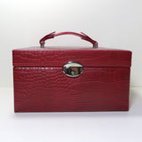 Large matt red jewellery case in faux crocodile finish.