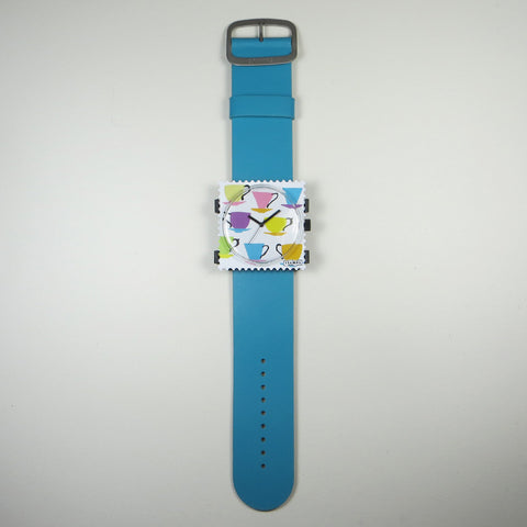 Coffee Party watch face on blue leather strap.